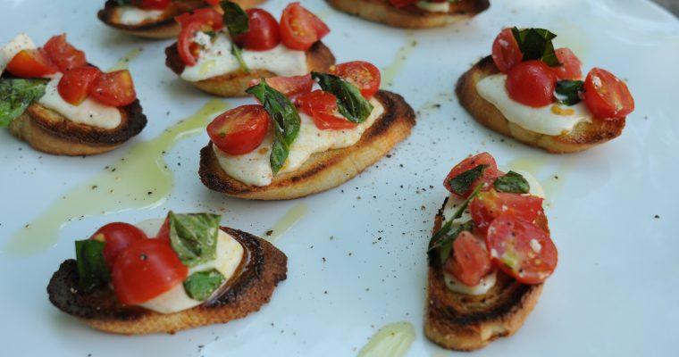 Marinated Tomatoes on Cheese Crostini